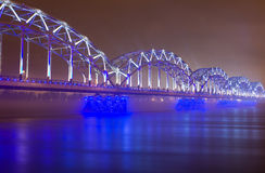 Railway Bridge At Night In Riga Stock Photos