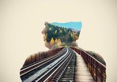 Railway bridge on the background behind the man Stock Image