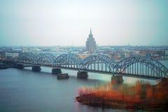 Railway bridge with the city of Riga as background stock photos