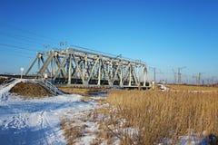 Railway bridge close-up in the daytime, winter season.  Stock Photos
