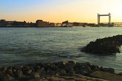 Railway bridge crossing the river in Dordrecht at sunset Stock Image