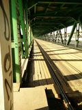 Railway bridge. Desolated railway bridge in Warsaw Poland. Perfect geometry made by construction and sun & shadows Royalty Free Stock Image