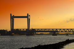 Railway bridge in Dordrecht at sunset with a dramatic sky Stock Photo