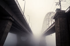 Railway bridge in the fog Stock Photos