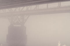 Railway bridge in the fog. In the morning royalty free stock images