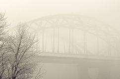 Railway bridge in the fog Stock Photo