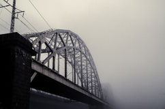 Railway bridge in the fog. In the morning royalty free stock photos