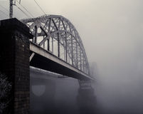 Railway bridge in the fog. In the morning royalty free stock photo
