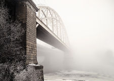 Railway bridge in the fog. In the morning royalty free stock photography