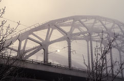 Railway bridge in the fog. In the morning n royalty free stock photo