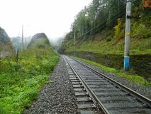 Railway bridge in the fog royalty free stock image