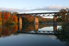 Railway bridge on the Grand River, Paris, Canada in fall. The Railway bridge on the Grand River, Paris, Canada in fall Royalty Free Stock Images