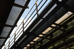 Railway bridge with grids and sight on the sky. Amsterdam Stock Photo