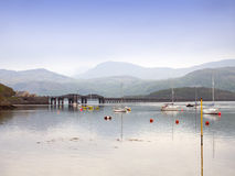 Railway bridge with harbour in Barmouth Gwynedd Wales UK Stock Images