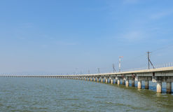 Railway bridge lead across the lake Stock Photos