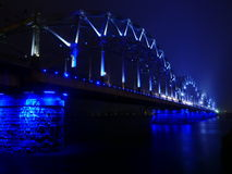 Railway Bridge lights in fog ,Riga. Bridge lights in fog in Riga, Latvia Stock Images