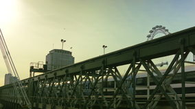 Railway on bridge, London Eye in the background stock video