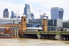 Railway Bridge and modern glazed office buildings,  Business center,  London, United Kingdom. LONDON, UNITED KINGDOM - JUNE 22, 2017: Railway Bridge and modern Royalty Free Stock Image
