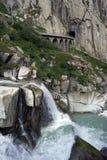 Railway bridge. And mountain rive near Andermatt in Switzerlandr Royalty Free Stock Photo