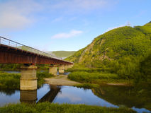 The railway bridge at a mountain slope Stock Images