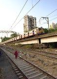 Railway bridge. A Mumbai Suburban Train climbs a Railway Bridge. Mumbai, India Stock Photo