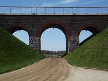 Railway bridge. Near the city of Kretinga. Apple is in another city falls people Royalty Free Stock Image