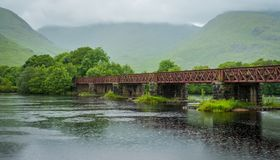 Railway bridge near Kilchurn Castle and Loch Awe, Argyll and Bute, Scotland. Kilchurn Castle is a ruined structure on a rocky peninsula at the northeastern end Royalty Free Stock Images