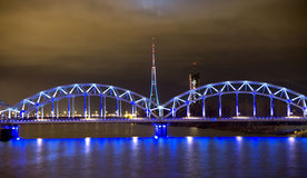 Railway bridge  at night in Riga Royalty Free Stock Photography