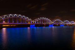 Railway bridge at night in Riga, Latvia Royalty Free Stock Photos