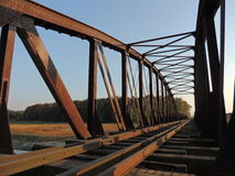 Railway Bridge. Old, closed railway bridge covered with rust Royalty Free Stock Images