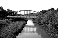 Railway bridge over the canal in Hungary. Hungarian countryside. Black and white photography. Stock Photos