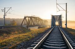 Railway bridge over the Irpin River in the autumn foggy morning. stock photos
