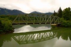 Railway bridge over a lake Stock Images