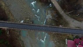 Railway bridge over mountain river. In Carpathians, top view stock video footage