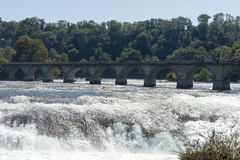 The railway bridge over The Rhine Falls, Switzerland Royalty Free Stock Images