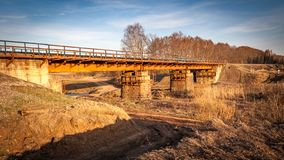 Railway bridge over the river. Railway bridge across the river for transportation of goods and passengers stock image