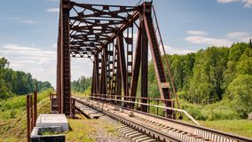 Railway bridge over the river. Railway bridge across the river for transportation of goods and passengers royalty free stock photo