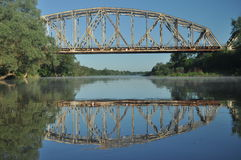 Railway bridge over the river. Bug valley. View of the metal structure Royalty Free Stock Images