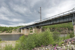 Railway bridge. Over the river  Chulman in South Yakutia Stock Images