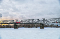 Railway bridge. Over the river covered with ice Royalty Free Stock Photos