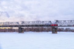 Railway bridge. Over the river covered with ice Stock Photography