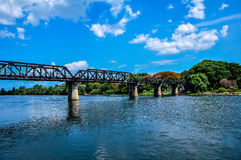 The railway bridge over the river that is made of steel. stock photo