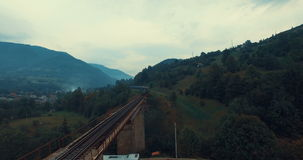 Railway bridge over the river and the mountain road stock footage