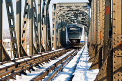 Railway bridge over the river olt, Romania. This is the main railroad bridge over the river Olt, near Slatina, Romania. Inside view in winter time, a train is Royalty Free Stock Photos