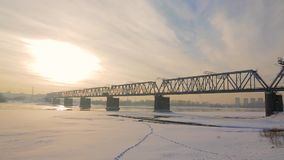 Railway bridge over the river. On the railway bridge over the river train rides stock video