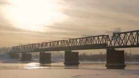Railway bridge over the river. On the railway bridge over the river train rides stock footage