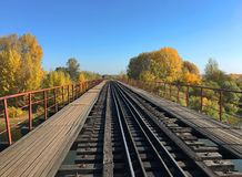 Railway bridge over the river under the blue sky stock photo