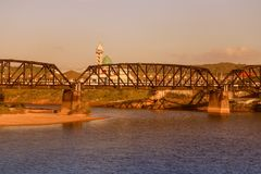 Railway bridge over a river with vintage sunset color tone and copy space add text.  Royalty Free Stock Photo