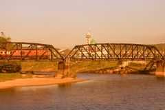 Railway bridge over a river with vintage sunset color tone and copy space add text.  Stock Photo
