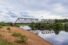 Railway bridge over the river Volchina. The beach next to the railway bridge, Maksatikha station Stock Photo